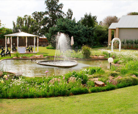picturesque garden with fountain